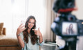 Young Woman Recording Her Video On Camera Mounted On Tripod. Royalty Free Stock Images - 91716489