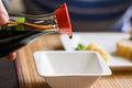 Pouring Soy Sauce In White Bowl Stock Photo - 91730320