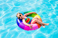 Child With Toy Ring In Swimming Pool Stock Photos - 91732893