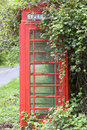 Red K6 Phone Box Covered By Brambles Royalty Free Stock Photography - 9182867
