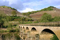 Vineyards On Mountain Slopes And Ancient Bridge Stock Photography - 91801292