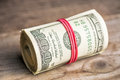 Roll Of Hundred Dollars Stock Photography - 91805652