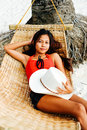 Beautiful Young Woman Relaxing On Rattan Hammock On The White Sand Beach During Travel Vacation Royalty Free Stock Photo - 91813725