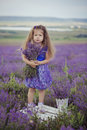 Pretty Young Girl Sitting In Lavender Field In Nice Hat Boater With Purple Flower On It. Royalty Free Stock Images - 91835969