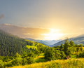 Sunset Over A Green Mountain Valley Stock Photo - 91838580