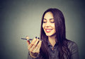Girl Using A Smart Phone Voice Recognition Function On Line Stock Photography - 91855162