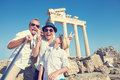 Funny Family Take A Selfie Photo On Apollo Temple Colonnade View Stock Photo - 91857520
