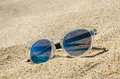 Sunglasses On The Beach. Multi Colored Stylish Model With Transparent Frame And Blue Lenses. Vacation Concept. Royalty Free Stock Photo - 91857835