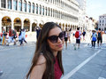 Smiling Girl With Sunglasses, Woman Model, In St Mark`s Square Venice With Tourists And Church On The Bottom, Venice, Italy Summer Royalty Free Stock Photography - 91867937