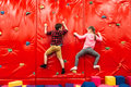 Kids Climbing On A Wall In Attraction Playground Royalty Free Stock Image - 91924706