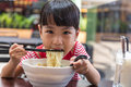 Asian Little Chinese Girl Eating Noodles Soup Royalty Free Stock Images - 91952699