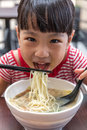 Asian Little Chinese Girl Eating Noodles Soup Stock Photography - 91952732