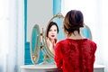Young Woman Looking At Mirror Stock Images - 91962894