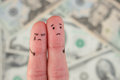 Fingers Art Of Displeased Couple On Background Of Money. Royalty Free Stock Photo - 92016435