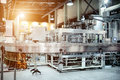 The Filling Machine Pours Beer Into Plastic PET Bottles. Royalty Free Stock Photography - 92021977