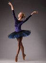 Incredibly Beautiful Ballerina In Blue Outfit Is Posing And Dancing In Studio. Classical Ballet Art. Royalty Free Stock Images - 92042079