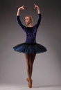 Young And Incredibly Beautiful Ballerina In Blue Outfit Is Posing And Dancing In Studio. Classical Ballet Royalty Free Stock Photo - 92042165