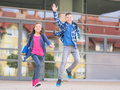 Boy And Girl With Books And Backpacks Stock Photo - 92042810