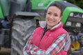 Young Female Agricultor On Field Tractor In Background Stock Photography - 92072902