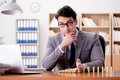 The Businessman With Dominoes In The Office Stock Images - 92117024