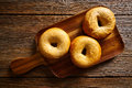 Bagels In A Wooden Board Stock Images - 92117334