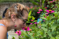 Woman Sniffing Flowers Outdoors In The Park Of Tropical Exotic Bali Island, Indonesia. Stock Photos - 92126443