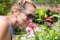 Woman Sniffing Flowers Outdoors In The Park Of Tropical Exotic Bali Island, Indonesia. Stock Photo - 92126590