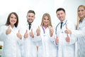 Smiling Team Of Doctors At Hospital Making Selfie And Showing Th Royalty Free Stock Image - 92147196