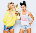Bright Juicy Portrait Of Two Cheerful Girlfriends, Having Fun With Slice Pineapple And Smiling. Casual Style, Bright Royalty Free Stock Photos - 92166908