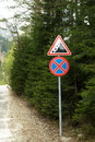 Road Signs On Mountain Road Next To The Green Pines Royalty Free Stock Photo - 92173315