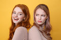 Happy Young Redhead Lady Near Angry Blonde Woman. Royalty Free Stock Photo - 92191075