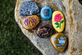 Group Of Painted Rocks On A Small Boulder Stock Image - 92220511
