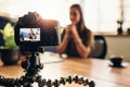 Digital Camera On Flexible Tripod Recording A Video Of Woman At Royalty Free Stock Photography - 92233677