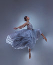 The Beautiful Ballerina Dancing In Blue Long Dress Stock Image - 92238981