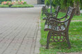 Metal Steel Old Fashioned Bench Chair On Green Grass. Royalty Free Stock Photography - 92300067