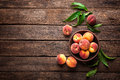 Fresh Juicy Peaches With Leaves On Dark Wooden Rustic Background, Above View Royalty Free Stock Photo - 92368015