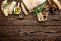 Delicious Homemade Italian Ciabatta Bread With Olive Oil And Olives On Wooden Rustic Background, Above View, Space For Text Royalty Free Stock Image - 92368106