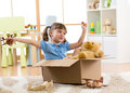 Child Playing With Plane Toy At Home. Travel, Freedom And Imagination Concept. Stock Photo - 92394820
