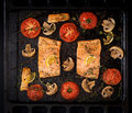 Baked Salmon Fish Fillet With Tomatoes, Mushrooms And Spices. Royalty Free Stock Images - 92405419