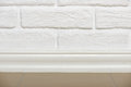 White Brick Wall With Tiled Floor Closeup Photo, Abstract Background Photo Stock Images - 92409824