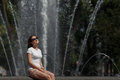 Beautiful Woman Sitting In Sunglasses On The Fountain Background Stock Image - 92412591