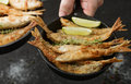 Fried Smelt In A Frying Pan On The Table With Spices, Lime And Thyme Royalty Free Stock Photos - 92413508
