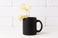 Black Coffee Mug Mockup With Soft Yellow Orchid Royalty Free Stock Images - 92433389