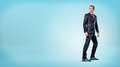 A Businessman Standing On Blue Background In Half Turn And Looking Over His Shoulder. Stock Photography - 92434412