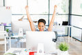 Portrait Of Smiling Afro-american Office Worker In Offfice Holding Her Arms Up Royalty Free Stock Image - 92450326