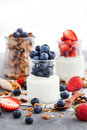 Delicious Plain Yogurt With Fresh Blueberry And Strawberry In A Royalty Free Stock Image - 92454096