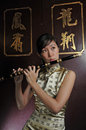 Beautiful Asian Woman Playing Flute Stock Image - 9253771