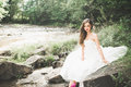 Portrait Of Stunning Bride With Long Hair Standing By The River Stock Photo - 92580890