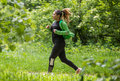 Girl Wearing Sportswear And Running In Forest At Mountain Stock Image - 92583521