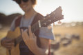 Close Up Of Young Man Playing Guitar While Standing On Field Stock Photos - 92589803